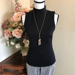 Quilted Sleeveless Turtleneck